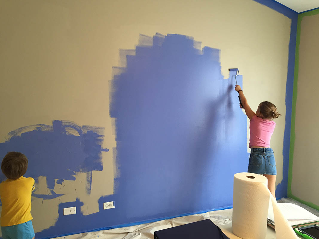 brother and sister painting their bedroom